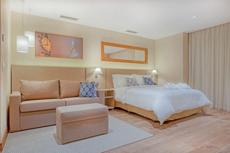 Apartamento PNE com cama casal e sofá